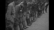 Soldiers bowing down in front of temple gate Stock Footage