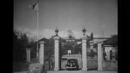 Cars entering and leaving palace gate for meeting Stock Footage
