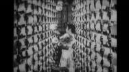 Woman placing bundles of thread on shelf Stock Footage