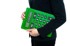 Stock Photo of Cropped image of a woman holding calculator