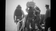 Soldiers throwing lifeboat in sea from ship deck Stock Footage