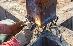 Welding metal and wood by electrode with bright electric arc Stock Photos
