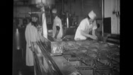 Plant personnel supervising factory worker working in the Blue Seal Dairy plant Stock Footage