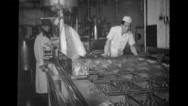 Plant personnel supervising factory worker at Blue Seal Dairy plant Stock Footage