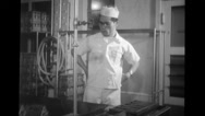 Worker working with crate at Blue Seal Dairy plant Stock Footage