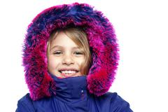 Stock Photo of Cheerful young girl in hooded fur jacket