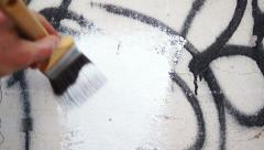Painting Over Graffiti Close Up Stock Footage