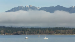 English Bay Fog and Peaks Stock Footage