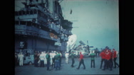 Military soldiers and sailors on the flight deck of USS Wasp Stock Footage