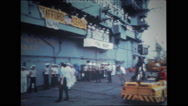 Tractor rolls up with television camera and man on hood on the deck of USS Wasp Stock Footage