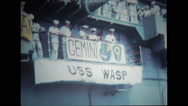 Sailors on the deck of USS Wasp looking down Stock Footage