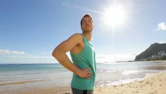 Portrait of fitness runner man resting after run Stock Footage