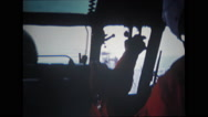 Helicopter in-flight and rear view of the pilot at controls Stock Footage