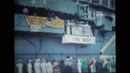 Sailors standing and watching from the deck of USS Wasp Stock Footage