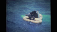 Rescue divers helping astronauts get out of the spacecraft Stock Footage