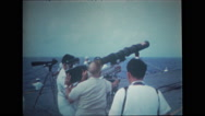 Photographers standing on the deck and filming USS Wasp Stock Footage