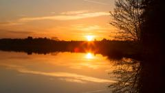 Sunrise time lapse - over the still waters of a lake - 25FPS - 4k timelapse Stock Footage