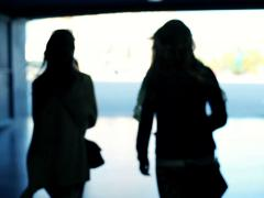 Silhouette of two women walking in tunel NTSC Stock Footage