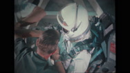 Astronaut in full spacesuit sitting on spacecraft couch Stock Footage