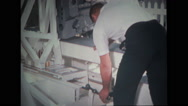 Technician working on spacecraft chair stand Stock Footage