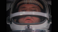 Astronaut looking through helmet Stock Footage
