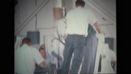 Astronaut getting up from couch with help of technicians Stock Footage