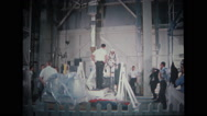 Astronaut getting on the stand and sitting in the couch Stock Footage