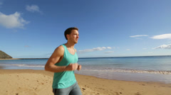 Running sport man jogging on beach Stock Footage