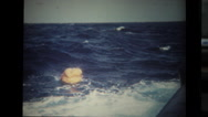 Sailor throwing life preserver in the ocean Stock Footage