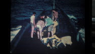 Sailors working on deck of submarine Stock Footage