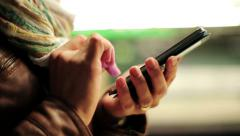 Woman hands texting on smartphone on metro station HD Stock Footage