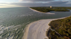 Wide aerial 2K view of Wiggens Pass in Naples, Florida Stock Footage