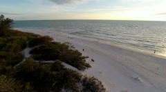 Naples Beach, 2K aerial footage flying over the beach at sunset Stock Footage