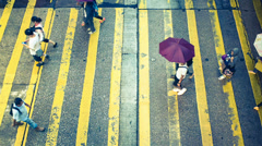 Pedestrians crossing timelapse in hong kong Stock Footage