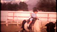 1068 - children riding horses at suburban horse ranch - vintage film home movie Stock Footage