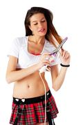 Pretty girl with fluting iron - stock photo