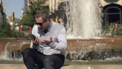Angry businessman talking on cellphone in city, slow motion, shot at 240fps HD - stock footage