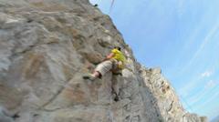 Rock climbing extreme camera swing around subject Stock Footage