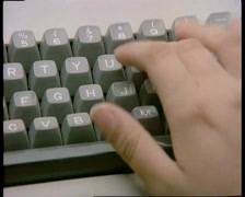 Close Up, Data Entry Into Old Computer Keyboard (1983) Stock Footage