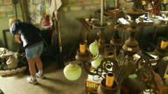 Stock Video Footage of Rummaging through a junk shop