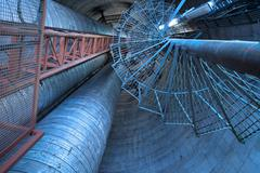 Equipment, cables and stairs as found inside of  industrial powe - stock photo