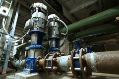 Equipment, cables and piping as found inside of  industrial powe Stock Photos