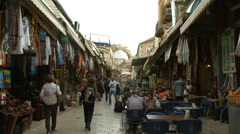 4K UHD Tourists visit bazaar market street old city Jerusalem Stock Footage