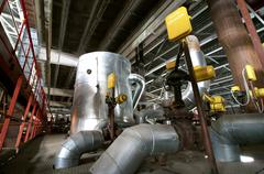 Equipment, cables and piping as found inside of  industrial powe - stock photo