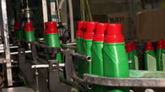 Green jars with red lids on the assembly line Stock Footage