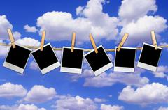 Polaroids on Sky Background Stock Photos