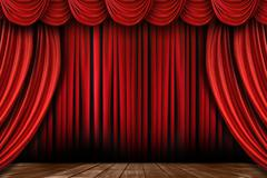 Bright Red Stage Drapes With Many Swags - stock photo