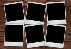 Polaroids on Planks - stock photo