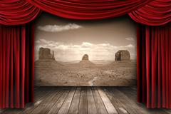 Red Theater Curtain Drapes With Desert Mountain Background - stock photo