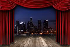 Theater Stage Curtain Drapes With a Night City as a Backdrop Stock Photos